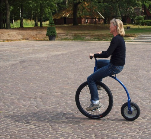 Marja shows off her skills on a penny farthing