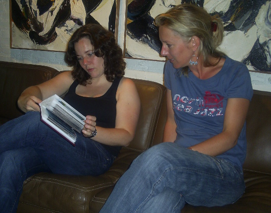 Maud and Annelies flick through Nigel's Bali album