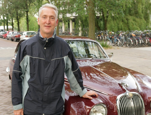 Nigel propping up a Jag and looking very pleased with himself